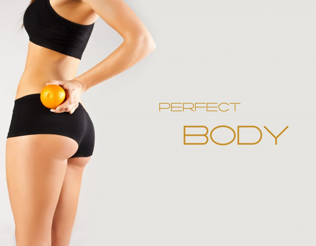 Perfect body. Woman holding an orange